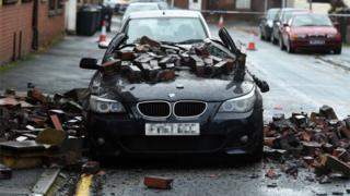 A BMW damaged by falling bricks