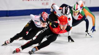Ice skaters racing