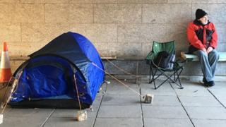 Homeless man an his tent