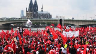 Supporters of Turkish President Recep Tayyip Erdogan attend a rally on 31 July 2016 in Cologne, as tensions over Turkey's failed coup put authorities on edge.