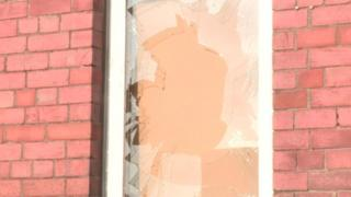 Two bricks were thrown at the house, smashing a front room window