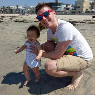 Matthew and his daughter on the beach
