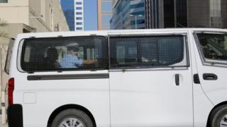 A prison van believed to be carrying some of the four detained American journalists leaves the Public Prosecution offices in Manama, Bahrain, (16 February 2016)
