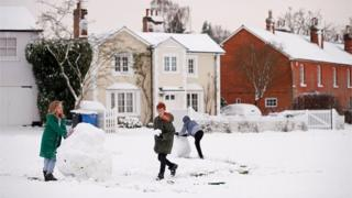 Children play in the snow in Hartley Wintney,