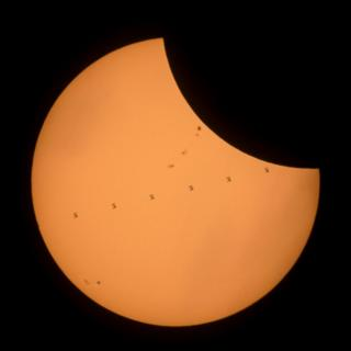 Space station moving across the Sun