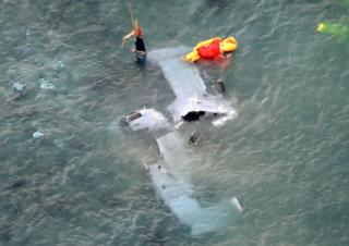 A wrecked U.S. Marine Corps MV-22 Osprey aircraft that crash-landed in the sea off Nago is seen in Okinawa Prefecture, Japan, in this photo taken by Kyodo 14 December 2016