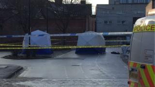 Police tape and tents erected at the scene