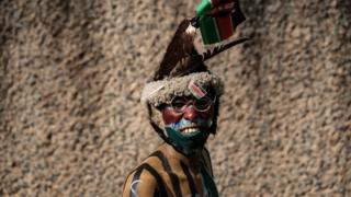 "A supporter of Kenya's Gor Mahia poses before the friendly football match Kenya""s Gor Mahia vs England""s Hull City at the Kasarani stadium in Nairobi on May 13, 2018."