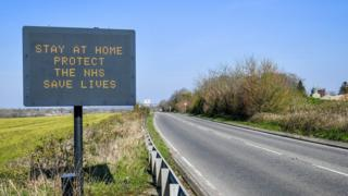 Stay home, save live road sign