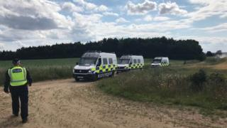 Police vans at rave site
