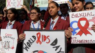 Indian school students taking part in an awareness campaign to mark World AIDS Day at a school on December 1, 2014