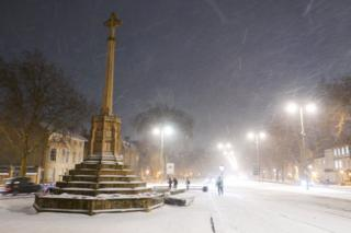 Snow falling on St Giles in Oxford city centre