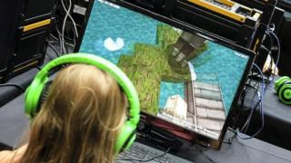 Girl playing Minecraft