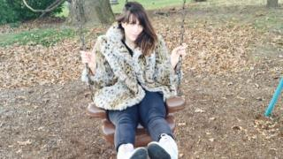 Rachel Syme on a swing