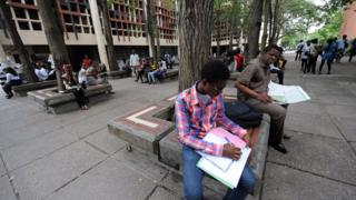 People dey relax under tree for University of Lagos