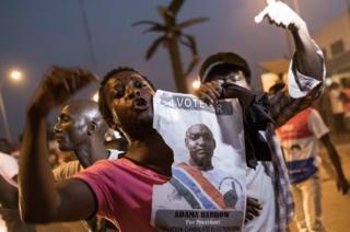 People celebrate the inauguration of new Gambia's President Adama Barrow in Banjui