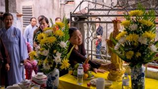 Relatives of the victims of the Essex lorry incident at a Buddhist prayer ceremony in Vietnam