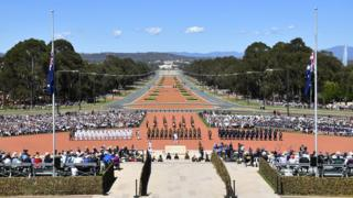 A guard of honour arrives during a Remembrance Day ceremony at the Australian War Memorial, in Canberra, Australia, 11 November 2018