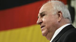 Helmut Kohl in front of a German flag