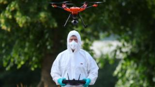 in_pictures Forensic police fly a drone at Forbury Gardens, in Reading town centre