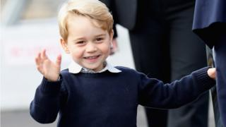 Prince George of Cambridge waves as he leaves from Victoria Harbour, Canada