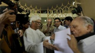 Indian writers hand over a memorandum to Vishwanath Prasad Tiwari, center, the current President of Sahitya Akademi, or National Academy of Letters, after a protest march in New Delhi, India,