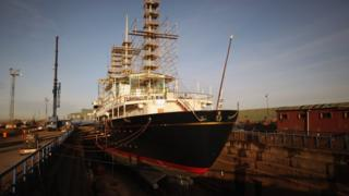 Workmen carry out painting and repairs on the Royal Yacht Britannia in a dry dock at Forth Ports on January 13, 2012 in Edinburgh, Scotland