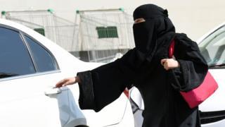 Woman from Saudi Arabia gets in car