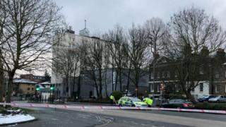 A police car can be seen inside the cordon in Walthamstow