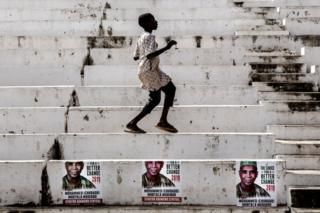 A boy dances at Ribadu Square, Jimeta, Adamawa State, Nigeria where the opposition Peoples Democratic Party (PDP) is set to hold a rally, on February 14, 2019. Nigerians will cast ballots on February 16 in presidential and legislative elections.