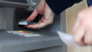 Person withdrawing money