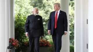 President Donald Trump and Indian Prime Minister Narendra Modi walk to deliver statements at the White House June 2017