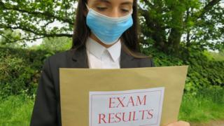 girl-holds-exam-results