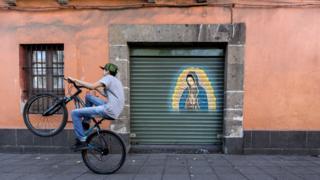 a cyclist on Plaza Loreto