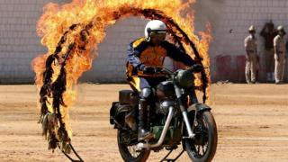 "An Indian Army Jawan (soldier) belonging to the ""ASC Tornadoes"" daredevil bike team performs during the 71st Republic Day celebrations in Bangalore, India, 26 January 2020."