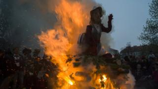 Bonfire burning an effigy of a witch