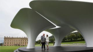 The Duke and Duchess of Devonshire view Lilas, by artist Zaha Hadid, one of the many monumental sculptures on display at Chatsworth stately home as part of the Sotheby's Beyond Limits Monumental Outdoor Sculpture Show