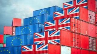 Shipping containers marked with EU and union flags