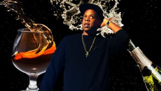 Jay Z with champagne and cognac splashing in the background