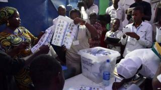 Elections workers count votes after polls closed following Chad's presidential election at a polling station in N'Djamena on 10 April 2016