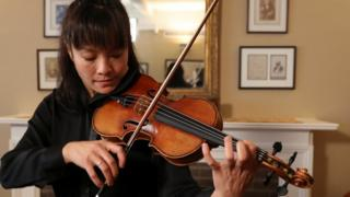 Violinist Mira Wang plays the Ames Stradivarius violin in Manhattan. New York. March 13, 2017