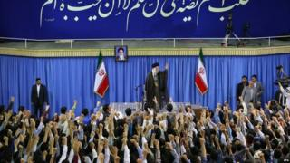 Iranian supreme leader Ayatollah Ali Khamenei (centre) greeting Iranian university students during a ceremony in Tehran (11 July 2015)