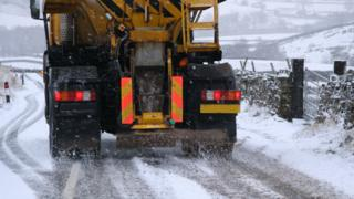 environment A gritter spreading salt on a road