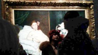 Deborah de Robertis in front of Edouard Manet's Olympia (Jan 2016)