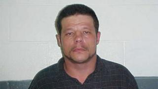 This June 2010 photo provided by the Kay County Detention Center shows Michael Vance, who is suspected in a double killing.