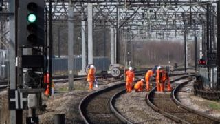 Rail workers on track
