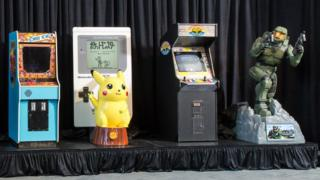 Donkey Kong arcade console, Pokemon's Pikachu in front of a giant Game Boy, Street Fighter II arcade console, and life size Halo figurine