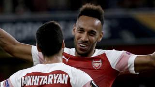 Pierre-Emerick Aubameyang celebrates with Henrikh Mkhitaryan