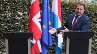 Xaviet Bettel standing next to empty lectern - where Boris Johnson should have been standing