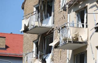 Damaged balconies and windows are seen at a block of flats that were hit by an explosion Friday morning, June 7, 2019